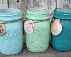 candles made in Mason jars painted to the color scheme of your wedding