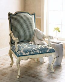 stripe + floral chair.  I love this chair.  I plan to recover my dining chairs and I never considered using two different patterned fabric.