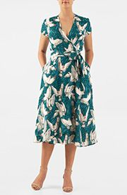 A split neck with floral embellished trim tops our floral print cotton poplin dress designed with floral embellished sheer tulle sleeves.