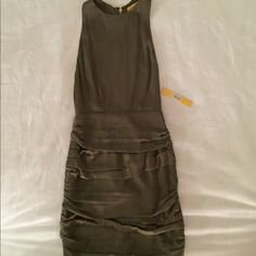 NWT Alice and Olivia silk olive mini dress Never worn (still with tags) silk racer back  dress with exposed zipper. Rushed mini skirt  and fitted through the bodice. Deep olive green color. Very flattering and sexy for a night out! Alice + Olivia Dresses Mini