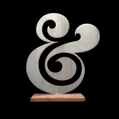 Own your own Ugmonk Premium Ampersand. Crafted from brushed aluminum, each ampersand sits on a oil-finished, solid walnut base. A perfect size for a tab. Typography Inspiration, Logo Design Inspiration, Typography Design, Creative Typography, Ampersand Tattoo, Calligraphy Words, Cursive Letters, Dave Matthews, Type Setting