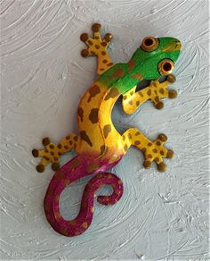 Our colorful fun Golden Toe Geckos are hand painted in vibrant Caribbean colors and are available in 9in, 13in and 18in sizes