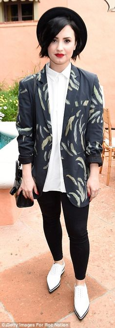 Demi Lovato sported a fun, patterned coat with form-fitting trousers as she arrived at the RocNation Pre Grammy Brunch in Beverly Hills