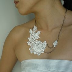 bridal lace and a broken chain could make something beautiful.