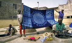 Africa | Hausa indigo cloth dyers, working at a communal dye pit.
