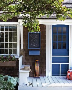 Love the blue color on this house. Chalk board at door is a cute idea for when people stop by and you aren't home.