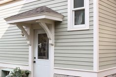 Bricks & Honey: Building the Back Door Overhang -- need to do this Porch Canopy, Backyard Canopy, Garden Canopy, Canopy Outdoor, Canopy Tent, Door Canopy, Ikea Canopy, Canopy Bedroom, Fabric Canopy