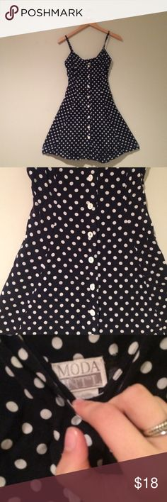 Vintage Dark Blue Polka Dot dress❤️ Beautiful dress. From Moda International which is from Victoria's Secret. Only known flaw is strap. I didn't notice until taking pic. Easily fixable, or can be left. ✂️Measurements: bust-16 inches . Length: 34 inches  💟Outfit Inspiration: 👰Help my fiancé and I save up for our wedding! 📦All purchases are shipped carefully and thoughtfully  🚭Smoke- free home ❗️Bundle to save on SHIPPING & TOTAL  💁Serious and reasonable offers only (no more  than 10% of…
