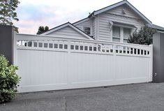 We like white or grey for the color. And something like this to open up to the driveway and garage. And then another door/gate that leads to the front door. Wooden Gates, Wooden Sliding Doors, Sliding Gate, Side Gates, Front Gates, Entrance Gates, Front Yard Fence, Aluminum Driveway Gates, Gate Designs Modern