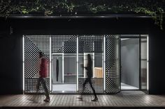 Responding to the urban context of the store, Linehouse realizes a curved stainless steel installation which operates as a retail system on the interior, as well as a dynamic façade treatment. Perforated stainless steel panels with a graphical treatment of varying punctures and patterns were inserted, shifting between the inside and outside.