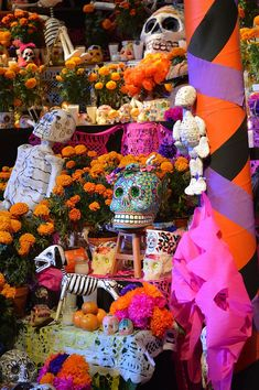 Day of  the Dead-Cempasúchil, alfeñiques and papel picado used to decorate an altar