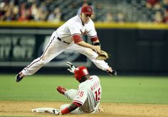 PHOENIX, AZ - APRIL 23: Infielder Aaron Hill #2 of the Arizona Diamondbacks throws over the sliding John Mayberry #15 of the Philadelphia Phillies to complete a double play during the ninth inning of the MLB game at Chase Field on April 23, 2012 in Phoenix, Arizona. The Diamondbacks defeated the Phillies 9-5. (Photo by Christian Petersen/Getty Images)