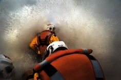 Inch Print (other products available) - Three crew members on board Porthcawl Atlantic 85 inshore lifeboat Rose of the Shires Shot looking forward from the stern, rough seas and spray. - Image supplied by RNLI Prints - Inch Photograph printed in the UK Republic Of Ireland, The Republic, Bailiwick Of Jersey, Rough Seas, Salford, Isle Of Man, Poster Size Prints, Canvas Prints, Image