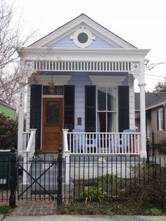 """An adorable lavender """"shotgun house"""" in New Orleans. My family lived in a shotgun house when I was growing up. You walked through the front door into my parents' bedroom and through theirs into mine. Small Cottages, Beach Cottages, Prefab Cottages, Cozy Cottage, Cottage Homes, White Cottage, Shotgun House Interior, Ing Civil, New Orleans Architecture"""