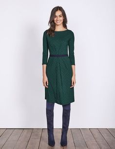 Subtle and sophisticated, this easy-going boat-neck dress will sail through workdays and weekends. The gathered pleats down the front create a sleek, flattering shape, while the grosgrain belt has a little stretch to keep you comfortable.