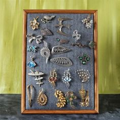 Here's an easy but effective way of displaying your vintage brooches - a padded frame!