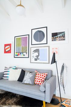 Art.com Gallery Wall at the Decorist Showhouse (futon + pillows are 9 by Novogratz for Walmart - yes!)