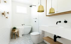 4 Warm Metal Fixture Ideas to Brighten Up Your Bathroom