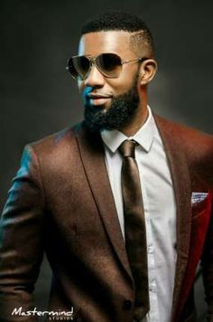 OAP DJ TTB showed up his formal and casual looks with suits, t-shirts, denim jackets and a luxurious black textured shirt. See more