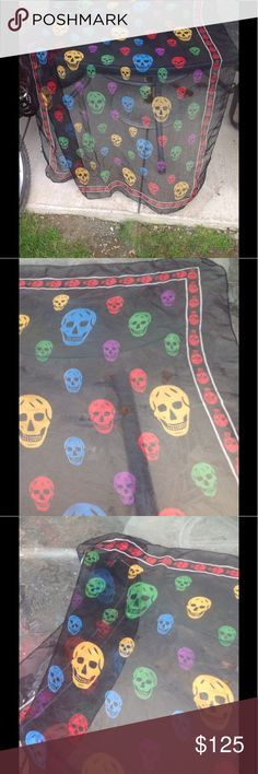 Authentic Alexander McQueen silk scarf Purchased from saks authentic Alexander McQueen black multi -color skull print silk scarf measures approx 50 inches wide  great Preowned condition Alexander McQueen Accessories Scarves & Wraps
