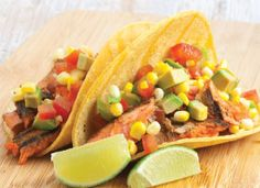 Grilled Salmon Tacos with Avocado-Corn Salsa: Summer is a great time to fire up the grill for these simple fish tacos, but this dish can also be easily prepared indoors on a grill pan.