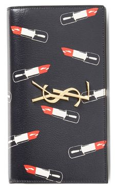 The quirky-cute lipstick print is such an eclectic twist on an otherwise classic YSL clutch.