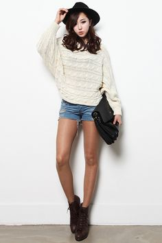 Horizontal cabled sweater with shorts and boots.