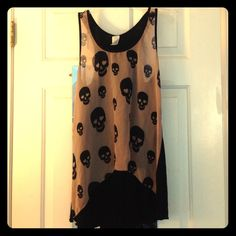 NWOT! Black and Brown High Low Skull Tank Top Skull Tank Top, Black and Brown skulls. Front it's see through, and back is incredibly soft. Size small but can easily fit a medium or large. Never worn! ISSI Tops Tank Tops