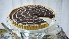 Mary's chocolatey custard tart is marbled with a pretty orange-flavoured white chocolate topping.