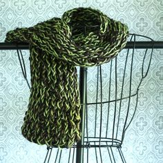 Super easy way to knit or crochet is by starting out with a loom! Learn how to make this cute DIY Scarf using a loom!