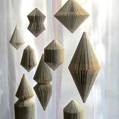 Book Art: Hanging Ornament BRILLIANT - folded Book. €23.00, via Etsy.