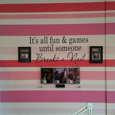 Love this pink and white striped nail salon wall.