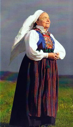 """Swedish folklore   Torna Härrad, Skåne (Scania)   The bocide, which is attached to the skirt, is decorated with four silver buckles (""""maljor"""") and are kept together with a silver chain (trädnål och silverkedja).   (""""Skandianvian Folklore III"""", Laila Durán, 2013)"""