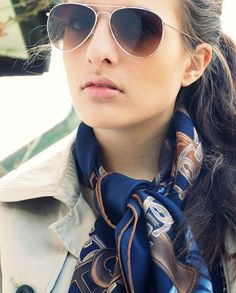 Aviators and a navy silk scarf - love this look!