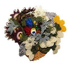 l oya needle crocheted brooch