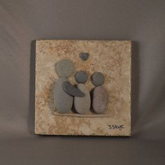 A family of three. 4x4 tile with felt backing. No stand made to display on a small stand. Your family rocks
