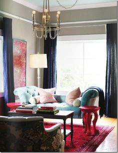 Neutral living room with navy, turquoise and red accents