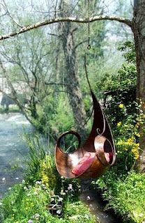 Such a fitting perch for any garden faerie. I simply adore this lily swing.