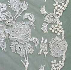 Fabulous antique French liturgical lace is hand embroidered with very fine satin stitched motifs of roses, flowers and foliage. Description from vintagepassementerie.com. I searched for this on bing.com/images