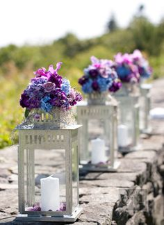 This site has a ton of beautiful flower ideas! I love the bunches of blue and purple flowers on top of lanterns as wedding centerpieces! (gold lanterns and flowers all shades of blue) Lantern Centerpiece Wedding, Wedding Lanterns, Candle Lanterns, Wedding Centerpieces, Wedding Decorations, Ikea Lanterns, White Lanterns, Centerpiece Ideas, Silver Lanterns