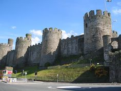 """Conwy Castle, Wales. A view of the castle's massive defensive wall and its original gateway. UNESCO considers Conwy to be one of """"the finest examples of late 13th century and early 14th century military architecture in Europe"""", and it is classed as a World Heritage site. The rectangular castle is built from local and imported stone and occupies a coastal ridge, originally overlooking an important crossing point over the River Conwy. Divided into an Inner and an Outer Ward. Read more --"""