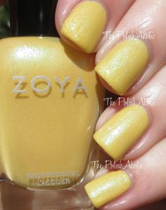 Daisy is a slightly pastel but mostly bright creamy yellow with blue green shimmer.