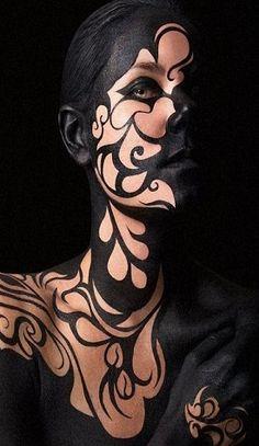 Body paint... black swirls... mysterious.