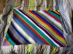 Bright colourful corner to corner lap blanket