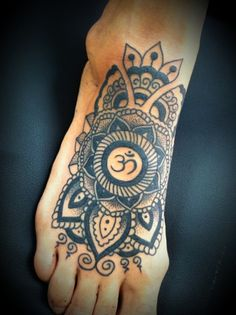 Ohm foot tattoo,  I would want more details though so the whole top of the foot is covered.