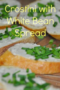 Simple vegetarian appetizer-use the food processor to whip up a cannellini (aka white kidney) bean spread, smear on toasted bread slices, and sprinkle with chives.