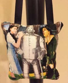 A personal favorite from my Etsy shop https://www.etsy.com/listing/493424228/wizard-of-oz-fabric-panel-scene-hanging