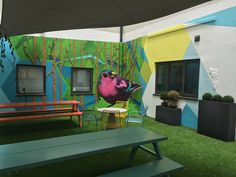 Shand House, Cardiff – transformation of communal courtyard for student accommodation. The feature murals had a funky and vibrant look, incorporating fun elements from nature including a 2m high Finch.   ##exteriormural #handpainted #educationmural
