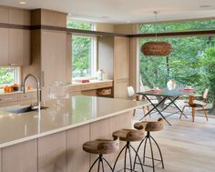modern kitchen with pendant light over breakfast table