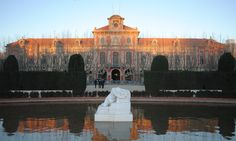 The Parliament of Catalonia, located in Parc de la Ciutadella. The statue of a woman in front of the building is called Desconsol (Distress; 1907), by modernist Catalan sculptor Josep Llimona i Bruguera (1864- 1934).